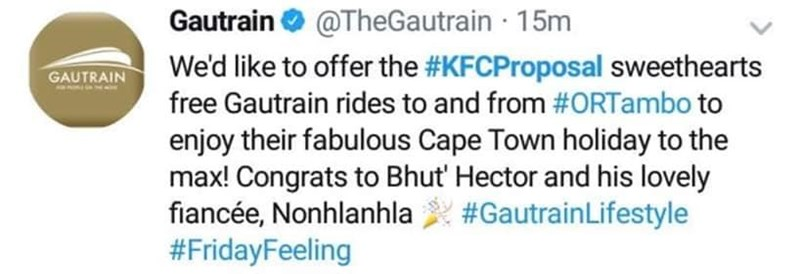 Text - Gautrain@TheGautrain 15m We'd like to offer the #KFCProposal sweethearts GAUTRAIN free Gautrain rides to and from #ORTambo to enjoy their fabulous Cape Town holiday to the max! Congrats to Bhut' Hector and his lovely fiancée, Nonhlanhla #Gautrain Lifestyle #FridayFeeling