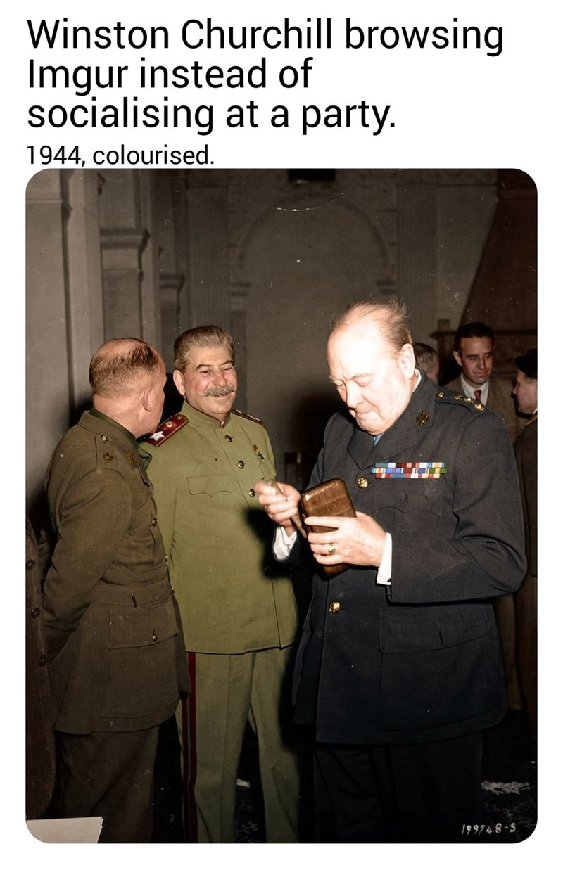 Photo caption - Winston Churchill browsing Imgur instead of socialising at a party. 1944, colourised. 199748-5
