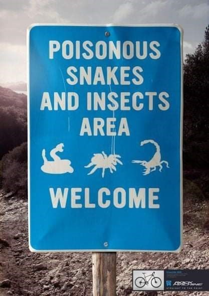 Sign - POISONOUS SNAKES AND INSECTS AREA WELCOME RE