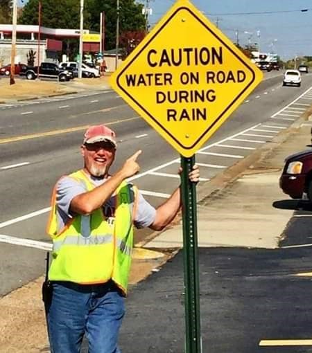 Traffic sign - CAUTION WATER ON ROAD DURING RAIN