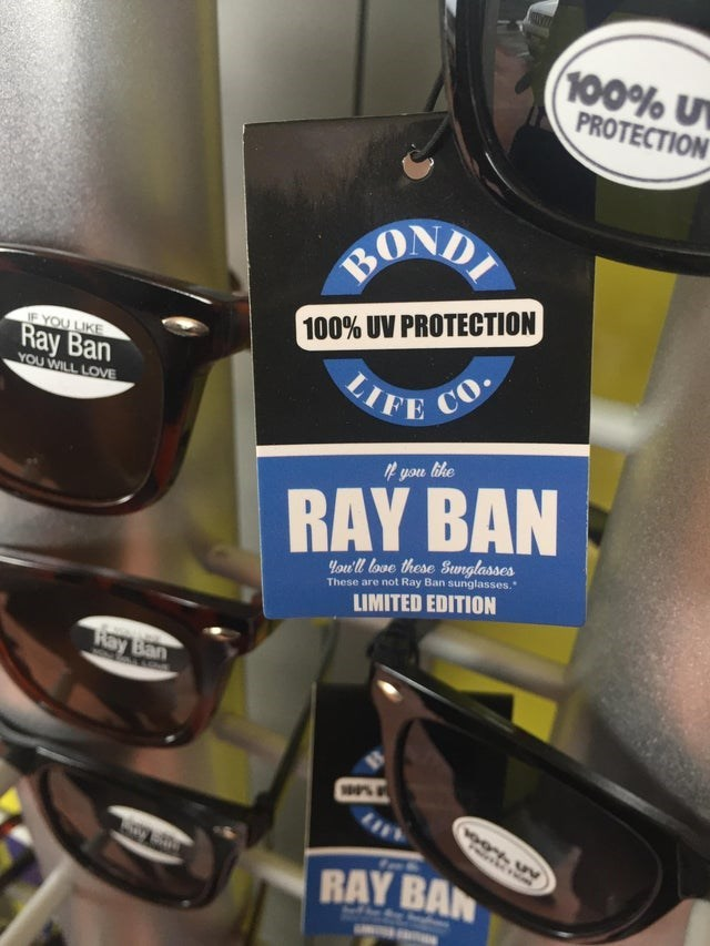 Eyewear - 100% U PROTECTION BOND 100% UV PROTECTION 1F YOU LIKE Ray Ban YOU WILL LOVE CO LIFE F yon like RAY BAN You'll love these Sunglasses These are not Ray Ban sunglasses. LIMITED EDITION Ray Ban RAY BAN