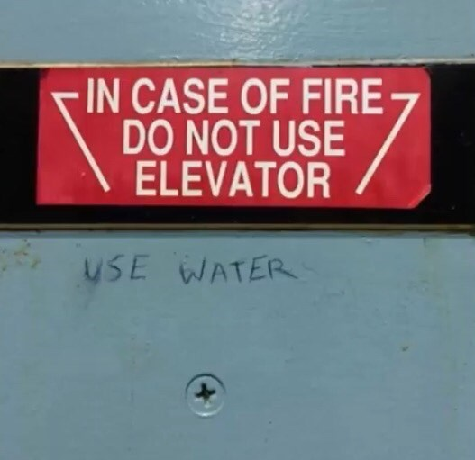 Text - IN CASE OF FIRE DO NOT USE ELEVATOR USE WATER