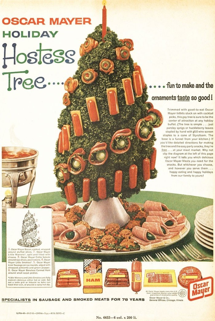 Vintage advertisement - OSCAR MAYER HOLIDAY Hostess Tree... .fun to make and the orhaments taste so good! Trimmed with good-to-eat Oscar Mayer tidbits stuck on with cocktail picks, this gay tree is sure to be the center of attraction at any holiday buffet. (The tree is simple.. just parsley sprigs or huckleberry leaves stapled by hand with #10 wire screen staples to a cone of Styrofoam. The base is a funnel from your kitchen.) If you'd like detailed directions for making the tree and the easy pa