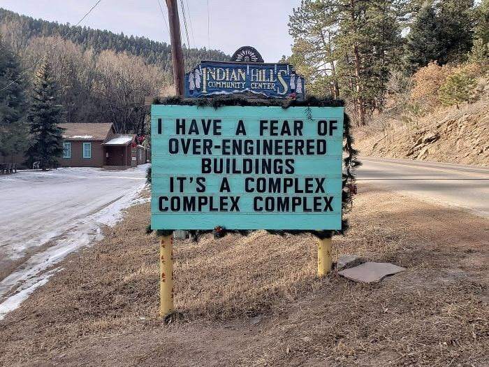 Signage - NINDIAN HILLL HAVE A FEAR OF OVER-ENGINEERED BUILDINGS IT'S A COMPLEX COMPLEX COMPLEX