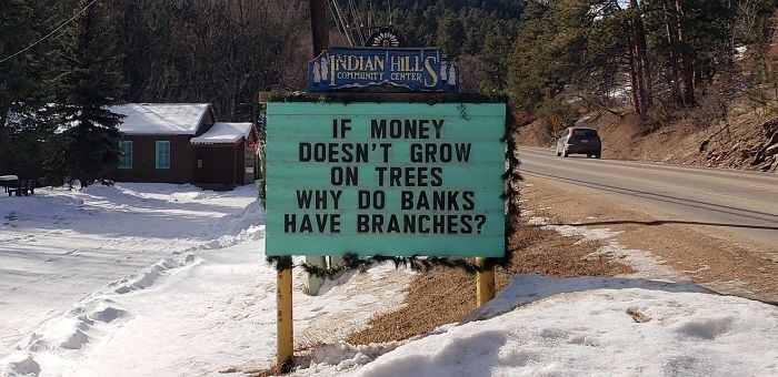 Sign - INDIAN HILL COMMUNIT CENTER IF MONEY DOESN'T GROW ON TREES WHY DO BANKS HAVE BRANCHES?