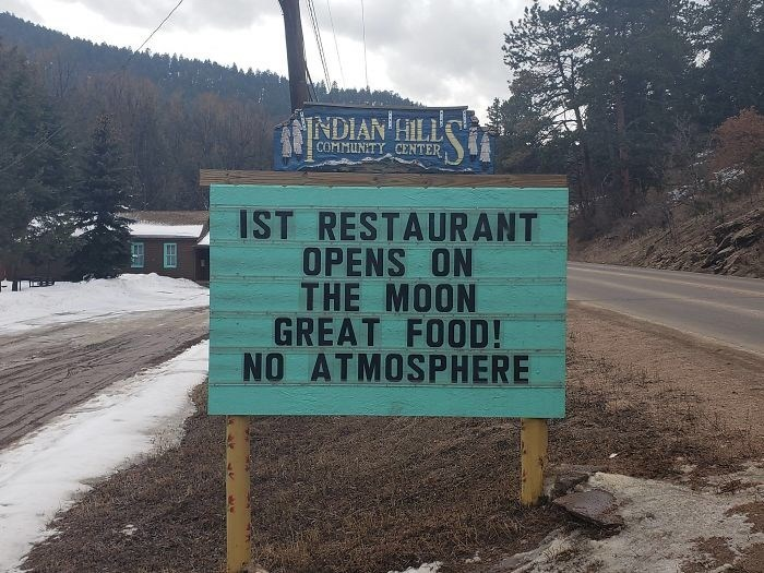 Street sign - INDIAN HILL COMMUNITY CENTER IST RESTAURANT OPENS ON THE MOON GREAT FOOD! NO ATMOSPHERE