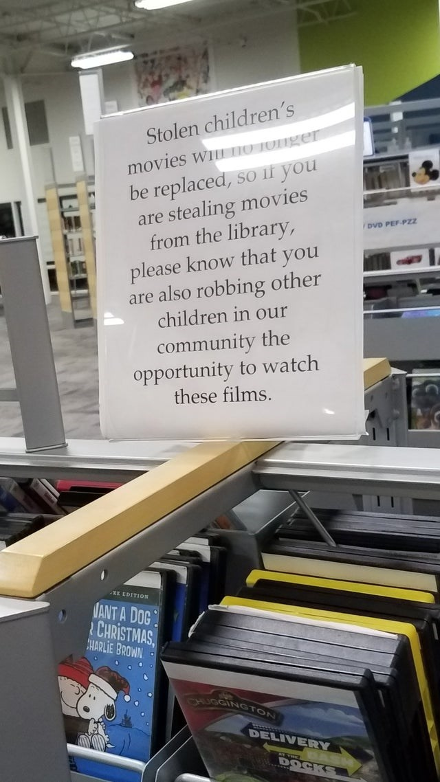 Text - movies wILnO TOnger be replaced, so il you are stealing movies from the library, please know that you are also robbing other children in our Stolen children's /DVD PEF-PZz community the opportunity to watch these films. XE EDITION NANT A DOG CHRISTMAS CHARLIE BROWN UGGINGTON DELIVERY Y THE DOCKS