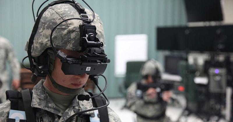 soldier wearing helmet and virtual reality head set