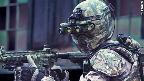 photo person in army suit face covered camera technology on eyes holding gun