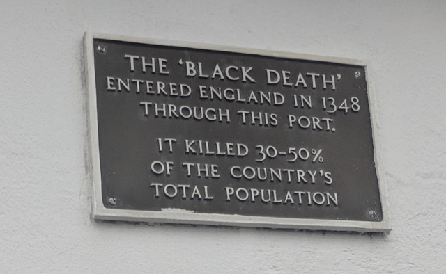 Commemorative plaque - THE 'BLACK DEATH' ENTERED ENGLAND IN 1348 THROUGH THIS PORT. IT KILLED 30-50%. OF THE COUNTRY'S TOTAL POPULATION