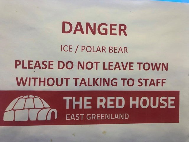 Text - DANGER ICE / POLAR BEAR PLEASE DO NOT LEAVE TOWN WITHOUT TALKING TO STAFF THE RED HOUSE I7O EAST GREENLAND