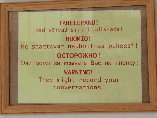 Text - TÄHELEPANU! Nad võivad siin lindistada! HUOMIO! He saattavat nauhoittaa puheesi! ОСТОРОЖНО! Они могут записывать Вас на пленку ! WARNING! They might record your conversations!