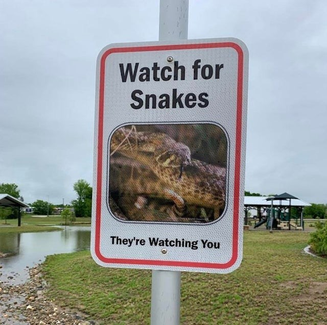 Sign - Watch for Snakes They're Watching You