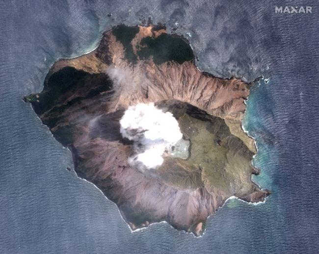 satellite photo of new zealand volcano eruption in sea island smoke plume