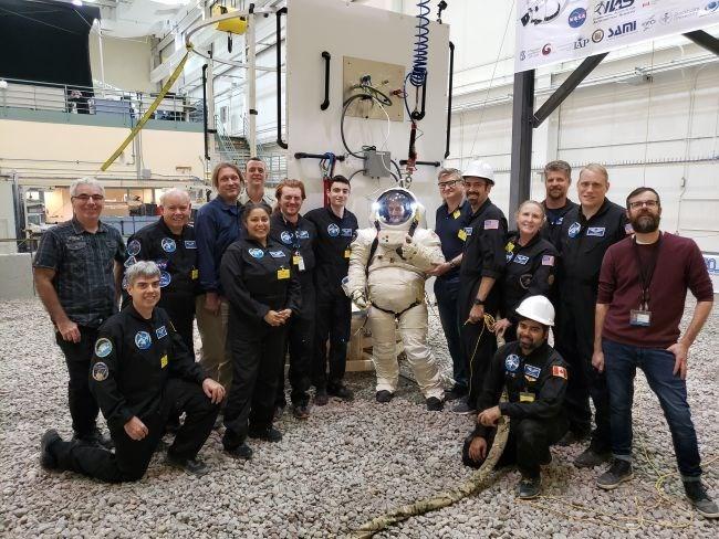 sixteen participants of the possum program people posing smiling group astronaut