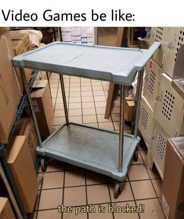 """Funny meme that reads, """"Video games be like"""" above a photo of a cart in the way with text below that reads, """"The path is blocked!"""""""