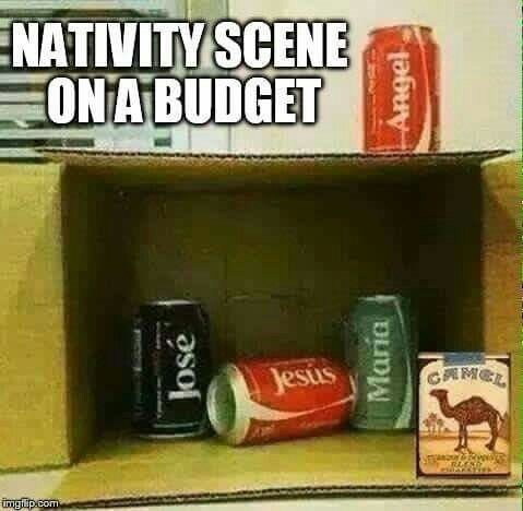 "Funny meme that reads, ""Nativity scene on a budget"" above a pic of a bunch of Coke cans and a pack of Camel cigarettes inside a cardboard box"