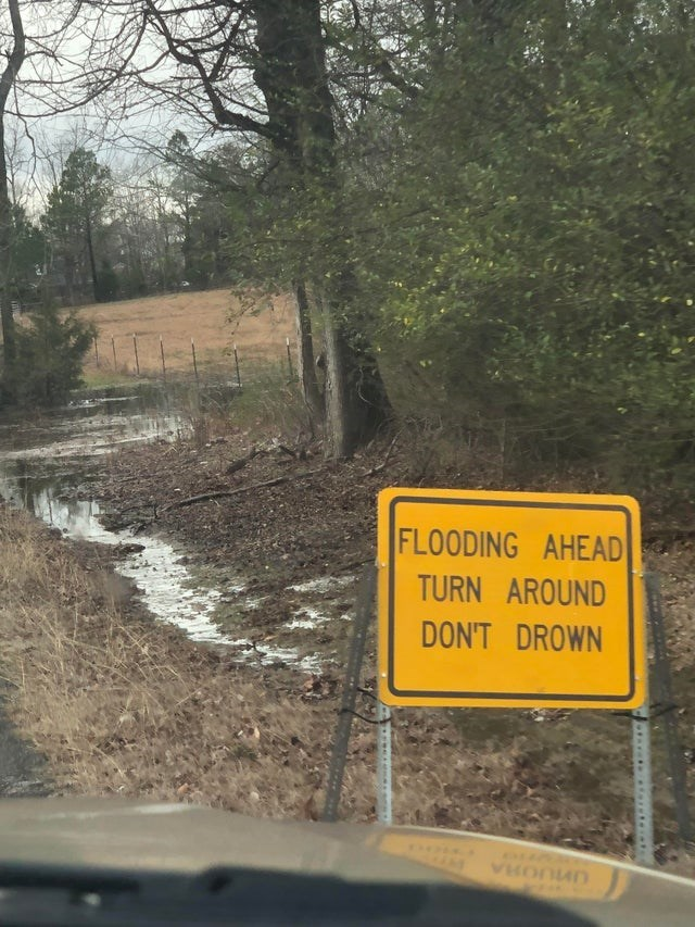 Sign - FLOODING AHEAD TURN AROUND DON'T DROWN