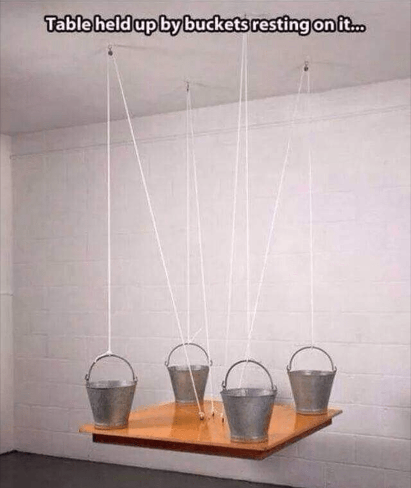Design - Table held up by buckets resting on it.