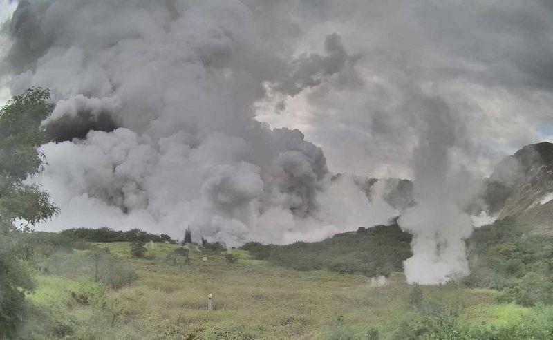 photo ash smoke clouds billowing green mountain taal volcano