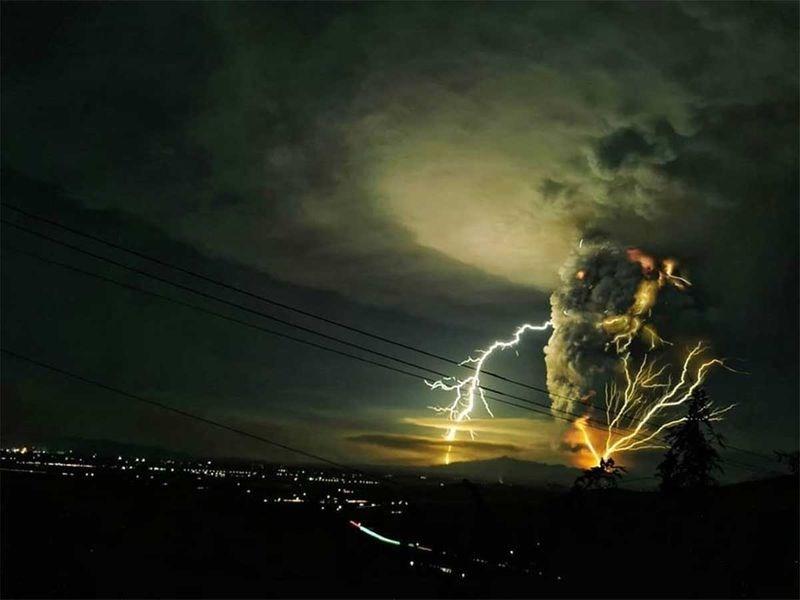 photo green black sky dark clouds volcano lightning