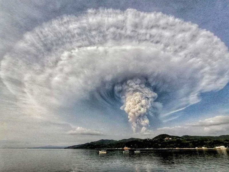 mushroom cloud rising from island philippines taal volcano