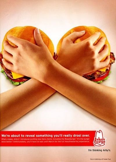 """Skin - We're about to reveal something you'll really drool over. What a tease. Arby's introduces enciting new menu kems including the Roastauroer"""" Hs the burger done belter Untortunately. you'l Nave to wait unti March for the full mouthwatering experience. Arby's I'm thinking Arby's."""