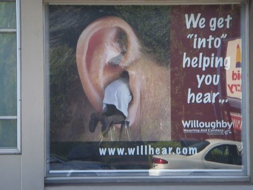"""Poster - We get """"into"""" helping bi you hear. Willoughby Hearing Ald Centers www.willhear.com"""