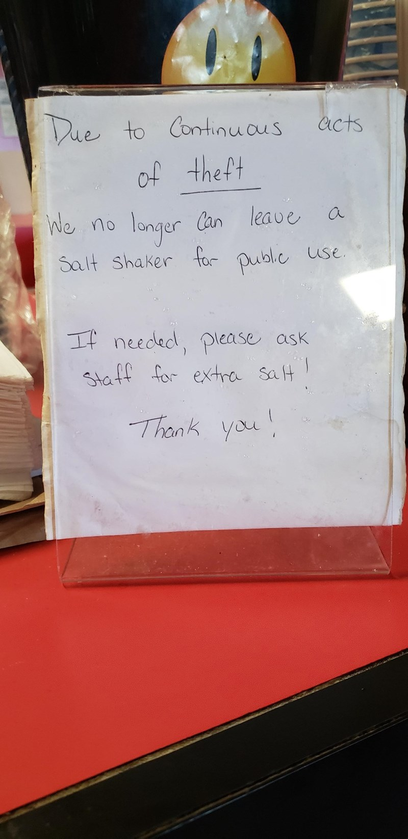 Text - Due to Continuaus Acts of theft longer Salt shaker for public use We no Can leave a If needed, please ask Staff for extra salt Thank you!