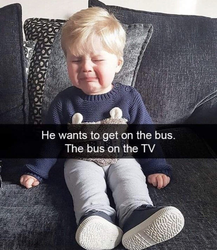 Child - He wants to get on the bus. The bus on the TV