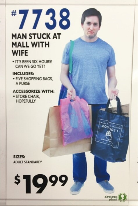 Bag - *7738 MAN STUCK AT MALL WITH WIFE • IT'S BEEN SIX HOURS! CAN WE GO YET? INCLUDES: • FIVE SHOPPING BAGS, A PURSE ACCESSORIZE WITH: • STORE CHAIR, HOPEFULLY PANCE 200 2011 JACO SIZES: ADULT STANDARD $1999 obvious plant