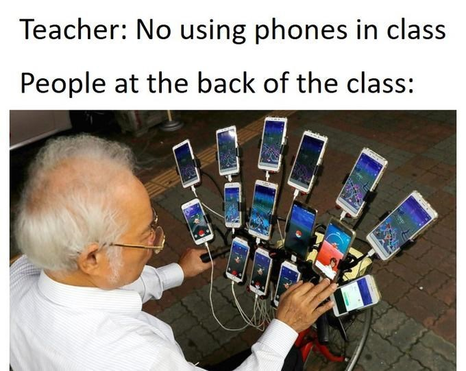 Hand - Teacher: No using phones in class People at the back of the class: