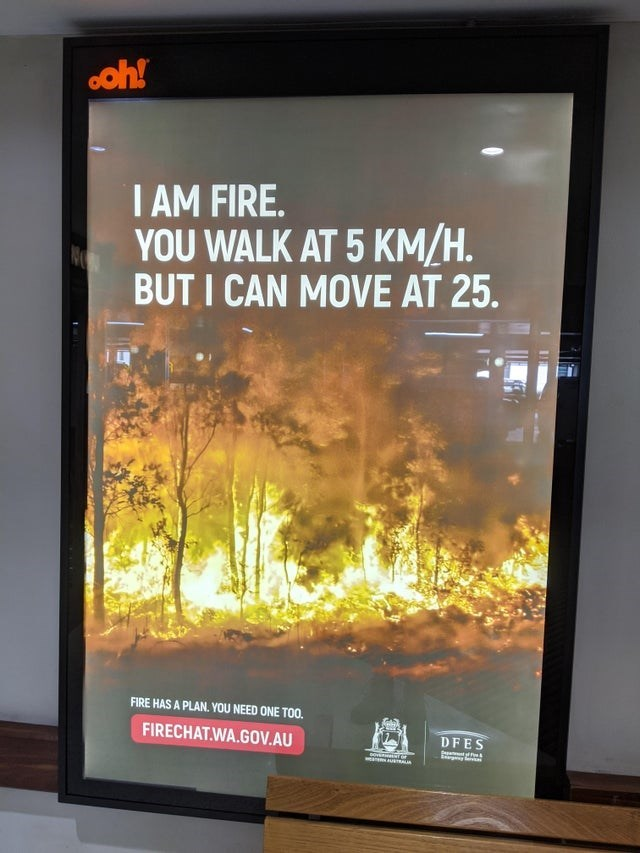 Display device - ooh! I AM FIRE. YOU WALK AT 5 KM/H. BUT I CAN MOVE AT 25. FIRE HAS A PLAN. YOU NEED ONE TO0. FIRECHAT.WA.GOV.AU DFES Tarsas a eTRALIA