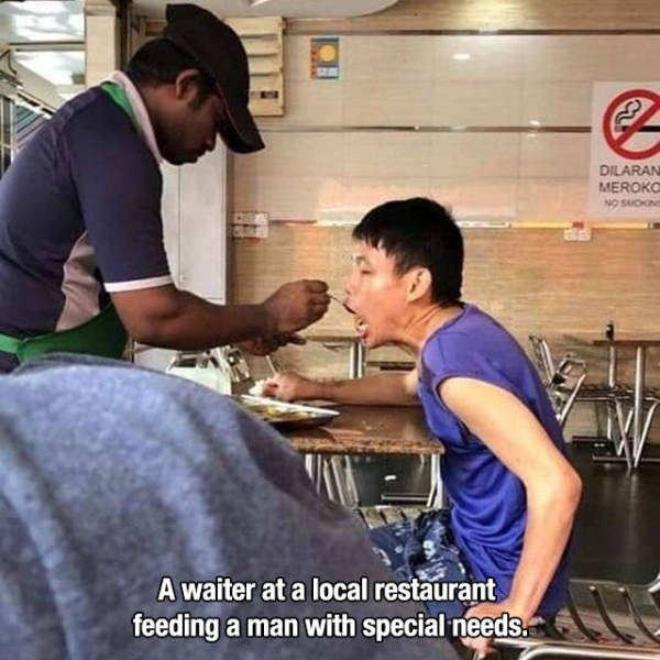 Muscle - DILARAN MEROKO NO SMOKN A waiter at a local restaurant feeding a man with special needs.
