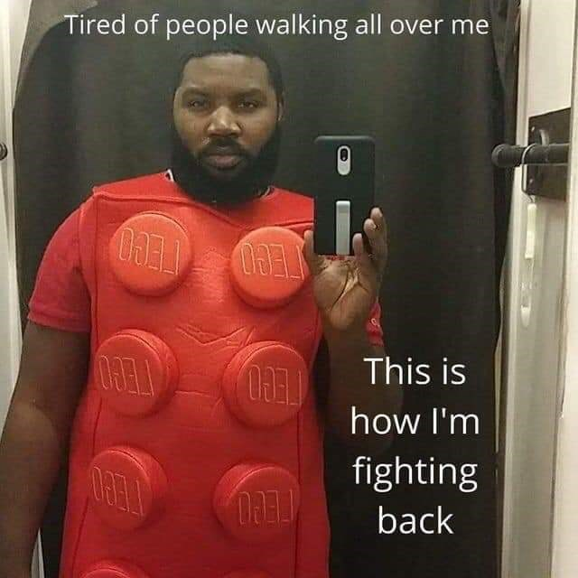 Funny meme of a guy wearing a Lego costume saying that he's tired of people walking all over him and that's fighting back with his Lego costume