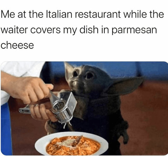 Meal - Me at the Italian restaurant while the waiter covers my dish in parmesan cheese PARA