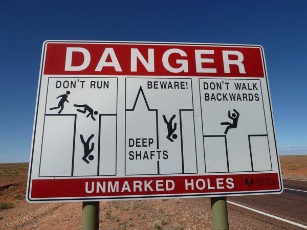 Sign - DANGER DON'T RUN DON'T WALK BACKWARDS BEWARE! DEEP SHAFTS UNMARKED HOLES