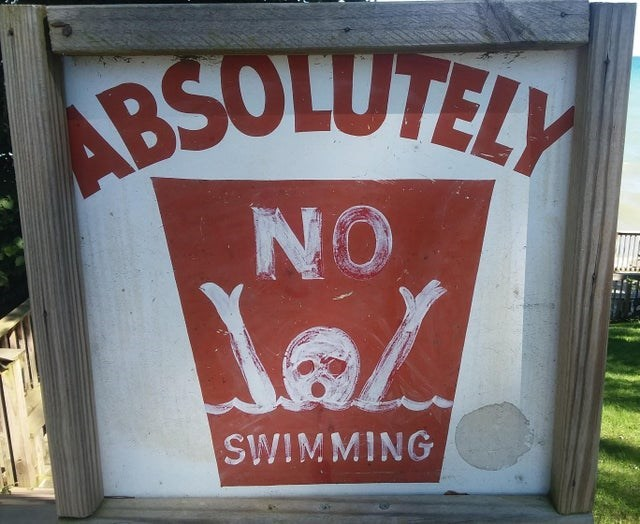 Text - BSOLUTELY NO SWIMMING