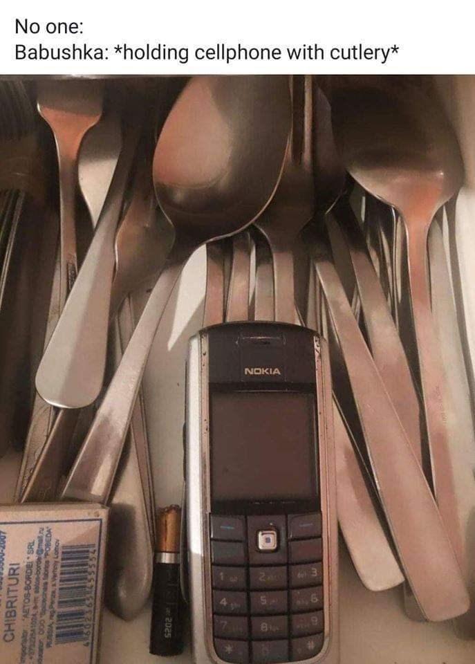 """Gadget - No one: Babushka: *holding cellphone with cutlery* NOKIA Zac CHIBRITURI mportator: AETOS-BORDE SRL 10A, ablon-bordemal.u dor 000pioecinas fabtes """"POBEDA RUSSIA gPera, Vertely Lomov 202s Un LO"""