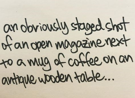 Font - an doviously staged shot of an open ma to a mug of coffee on an antique wooden table..