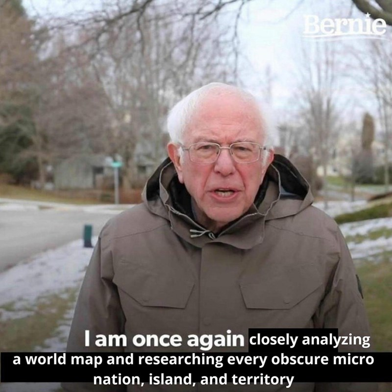 Photo caption - Bernie lam once again closely analyzing a world map and researching every obscure micro nation, island, and territory