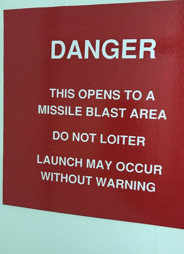 Text - DANGER THIS OPENS TO A MISSILE BLAST AREA DO NOT LOITER LAUNCH MAY OCCUR WITHOUT WARNING