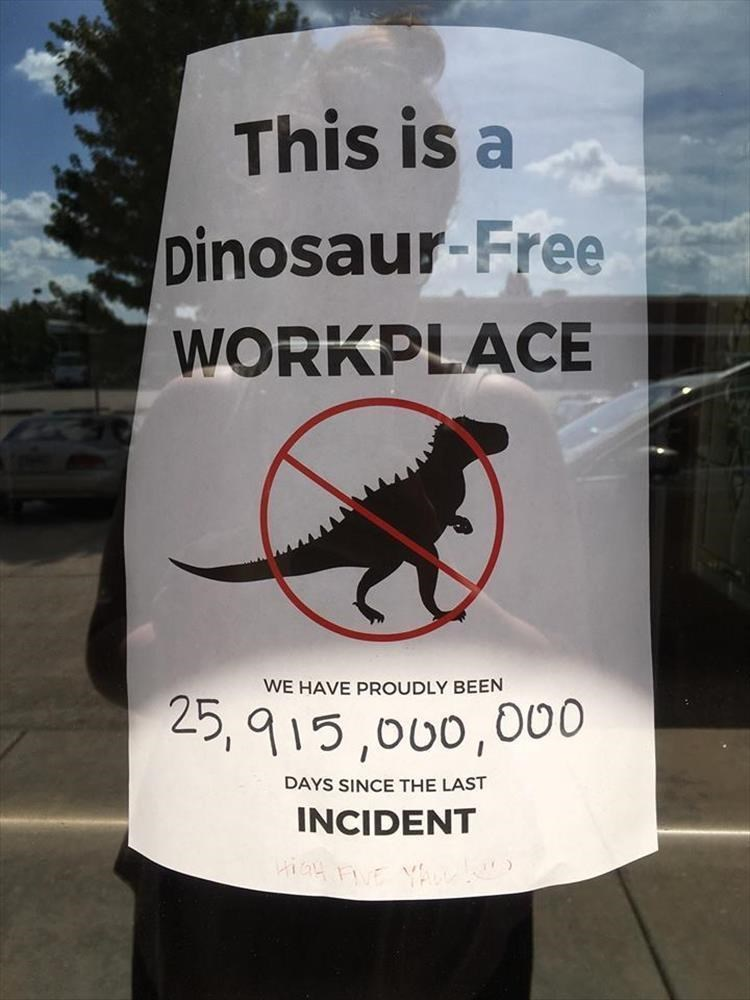 sign that reads This is a Dinosaur Free WORKPLACE WE HAVE PROUDLY BEEN DAYS SINCE THE LAST INCIDENT