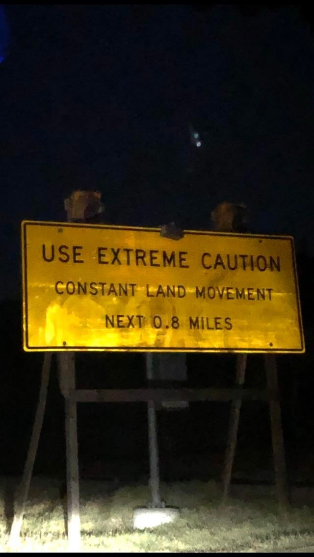 Text - USE EXTREME CAUTION CONSTANT LAND MOVEMENT NEXT 0.8 MILES