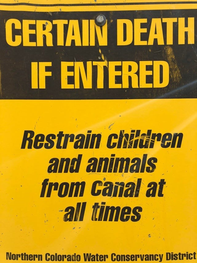 Font - CERTAIN DEATH IF ENTERED Restrain chitdren and animals from canal at all times Northern Colorado Water Conservancy District