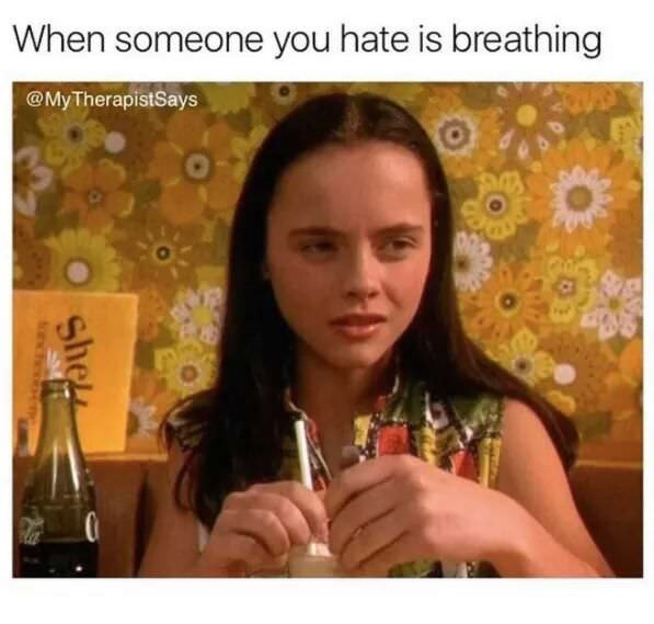 "Funny meme that reads, ""When someone you hate is breathing"" above a still of Christina Ricci looking annoyed"