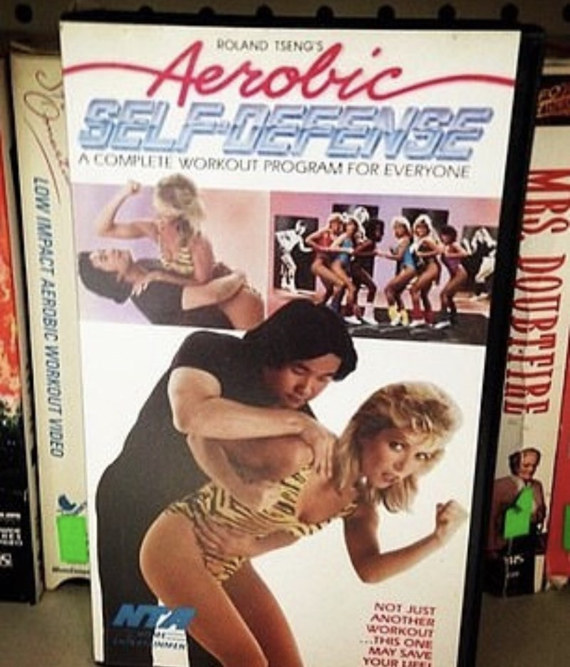 Leg - Aerobic SELF DEFENSE ROLAND ISENGS A COMPLETE WORKOUT PROGRAM FOR EVERYONE ANOTHER WORKOUT THIS ONE MAY SAVE YOUR LIFEL 1snr tON NTA 5003 IRS. DOUBEFRE LOW IMPACT AEROBIC WORKOUT VIDEO