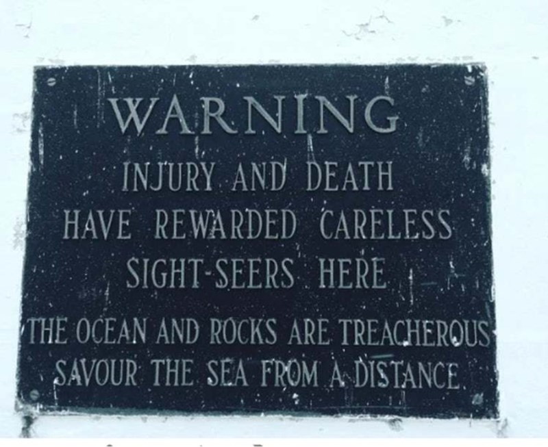 """Text - WARNING INJURY AND DEATH HAVE REWARDED CARELESS SIGHT-SEERS"""". HERE i THE OCEAN AND ROCKS ARE TREACHEROUS SAVOUR THE SEA FROM À DISTANCE."""