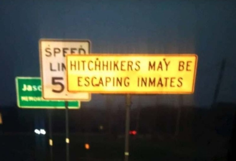 Street sign - SPEED LIN HITCHHIKERS MAY BE 5ESCAPING INMATES Jasc NEMORA