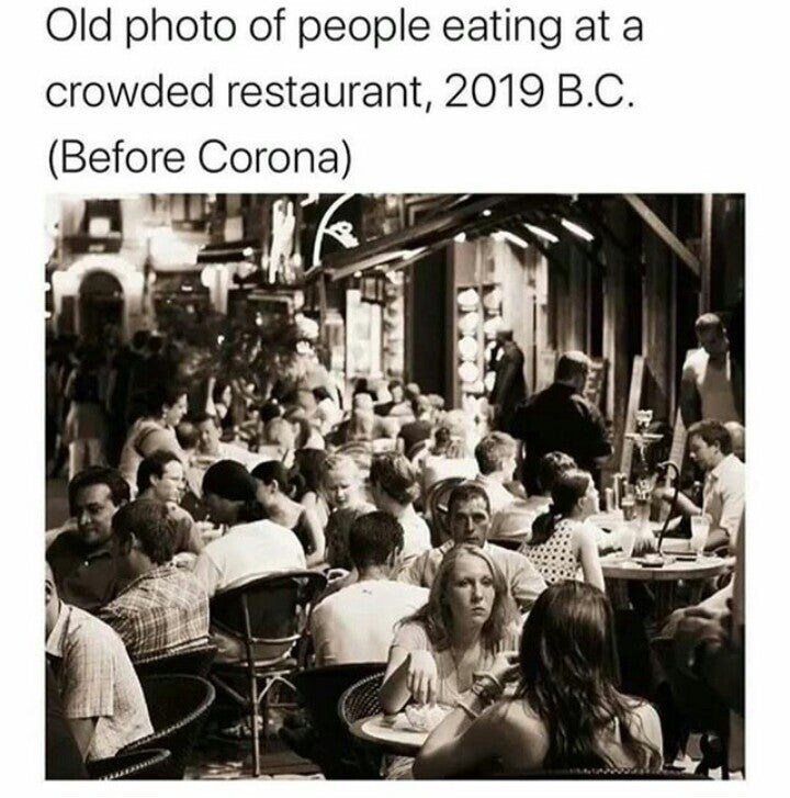 "Funny meme that reads, ""Old photo of people eating at a crowded restaurant, 2019 B.C. (Before Corona)"" above a black-and-white photo of people in a restaurant"